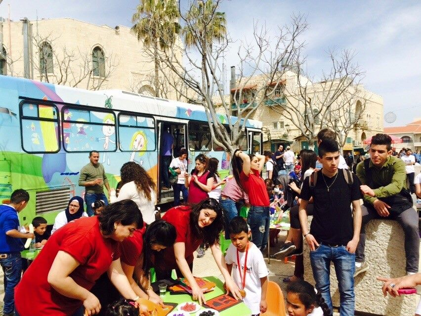 Al-Tufula's programme includes young activists travelling around the country in an art bus that visits Palestinian villages, so children get the chance to paint, enjoy arts and crafts and create together. Photo: al-Tufula