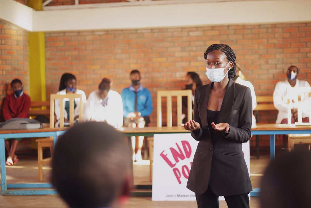 Divine Ingabire, executive director of I Matter Initiative, speaks at the school of G.S Musave Catholique. In partnership with Kvinna till Kvinna, they were able to donate packages of pads, soaps and underwear to the students. Photo: I Matter Initiative