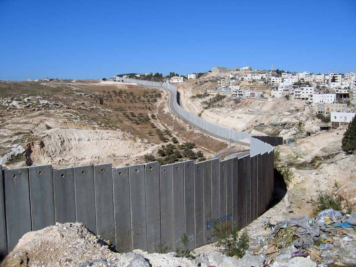 """The Israeli West Bank wall. As the occupying power, Israel has been violating international humanitarian law for many years when carrying out eviction of Palestinians. In a recent report, Human Rights Watch notes that certain """"deprivations are so severe that they amount to the crimes against humanity of apartheid and persecution""""."""