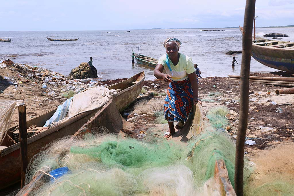 Tupee Nagbo, mother of seven, stands in the remains of her fishing business. She went bankrupt during the pandemic, after being in business for 25 years. Photo: Wolobah Sali